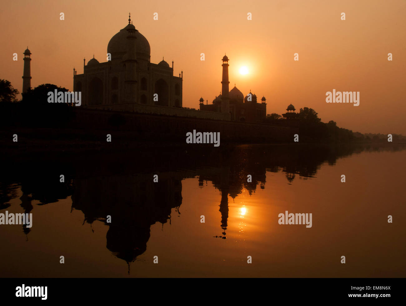 Sunset over the Taj Mahal taken from the Yamuna River in Agra, India Stock Photo