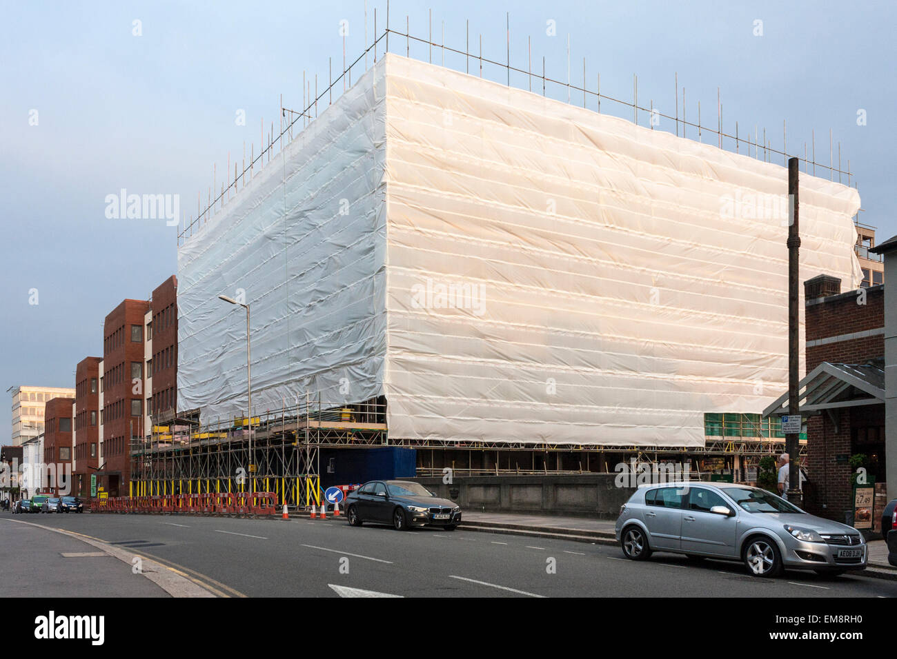 Protective plastic sheeting on scaffolding - Stock Image