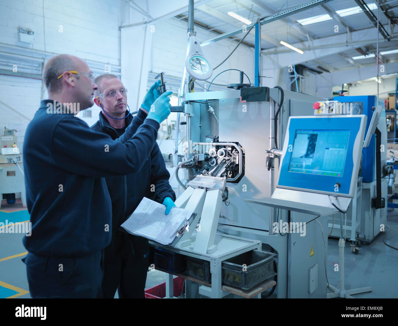 Engineers manufacturing automotive parts - Stock Image