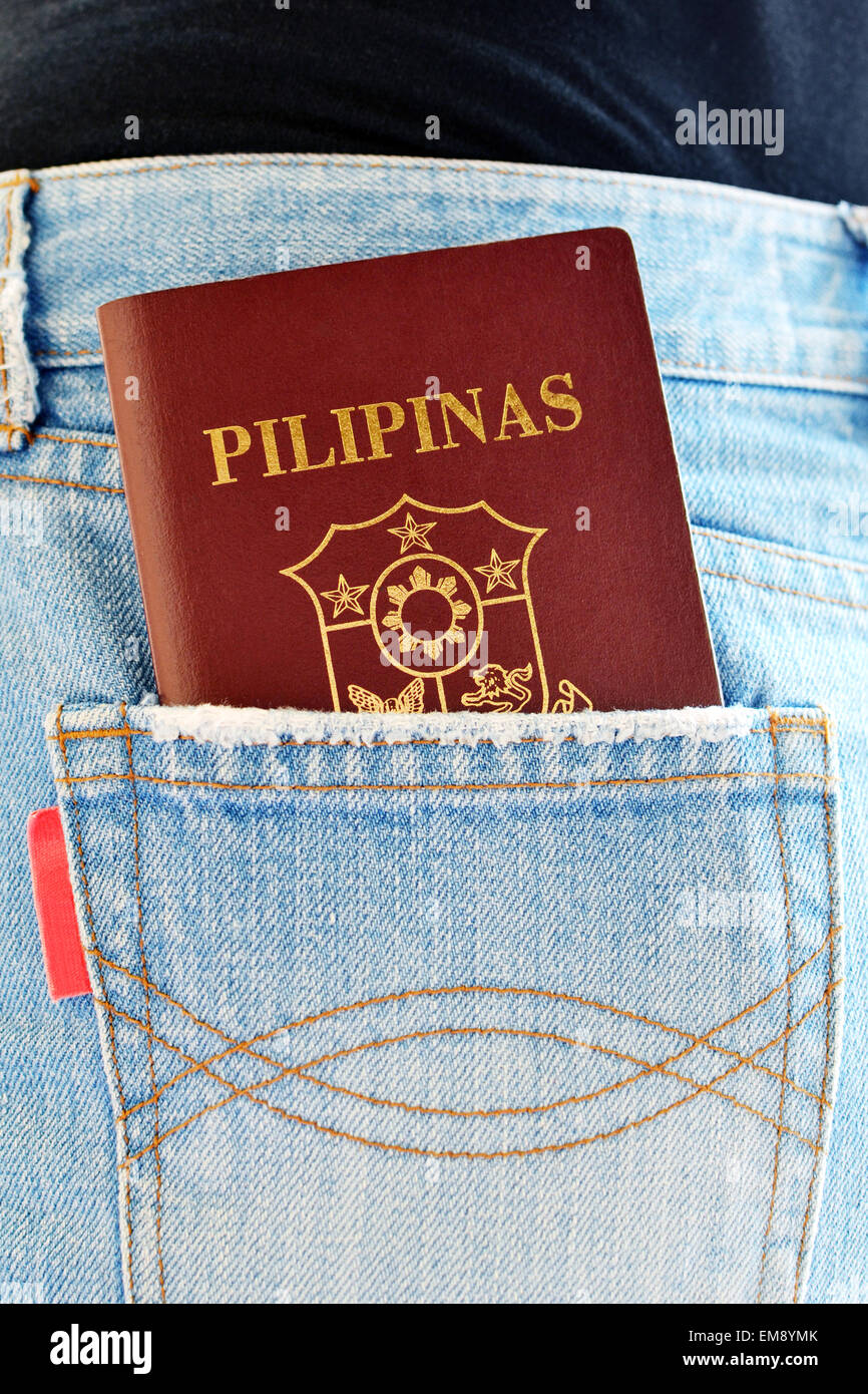 Filipino Passport exposed in rear pocket of jeans wear - Stock Image