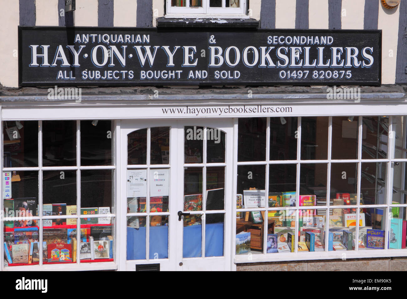 Hay on Wye 2015 Powys Wales bookshop booksellers window display selling used secondhand and antiquarian books April - Stock Image