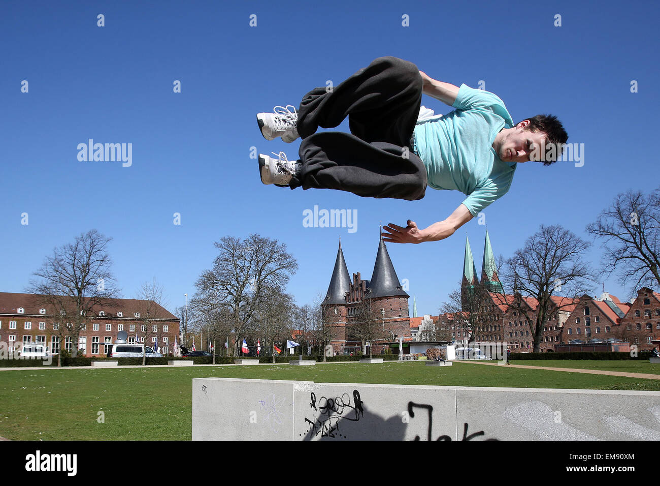 Luebeck, Germany. 15th Apr, 2015. Nils Marckwardt trains the sport 'parcours' and performs a 'free running - Stock Image