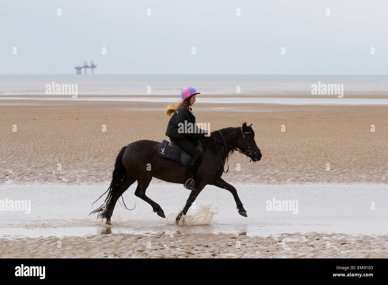 Horse riding on Ainsdale beach, Southport, Merseyside, UK. 17th April, 2015. UK Weather. Horses, Activities, sports - Stock Image
