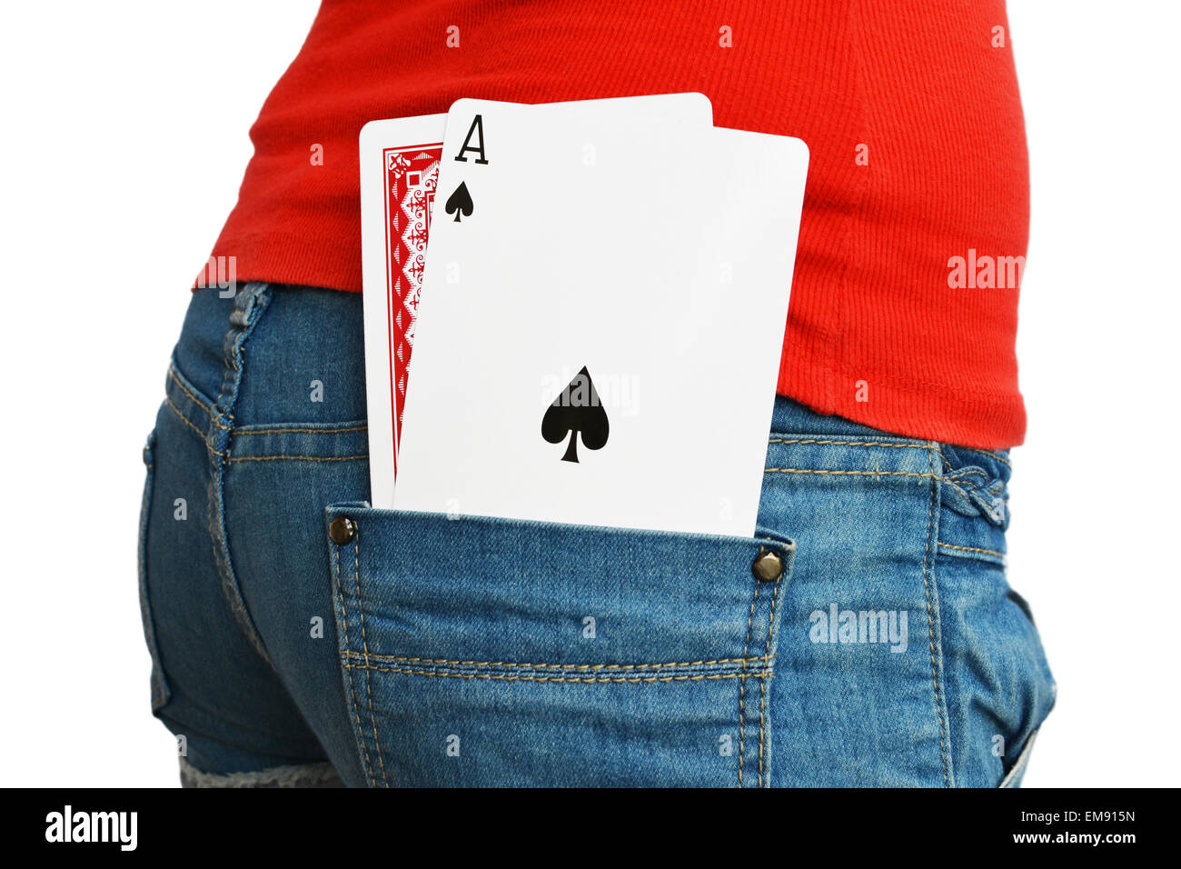 An ace and a hidden playing cards in a rear pocket of a jeans - Stock Image