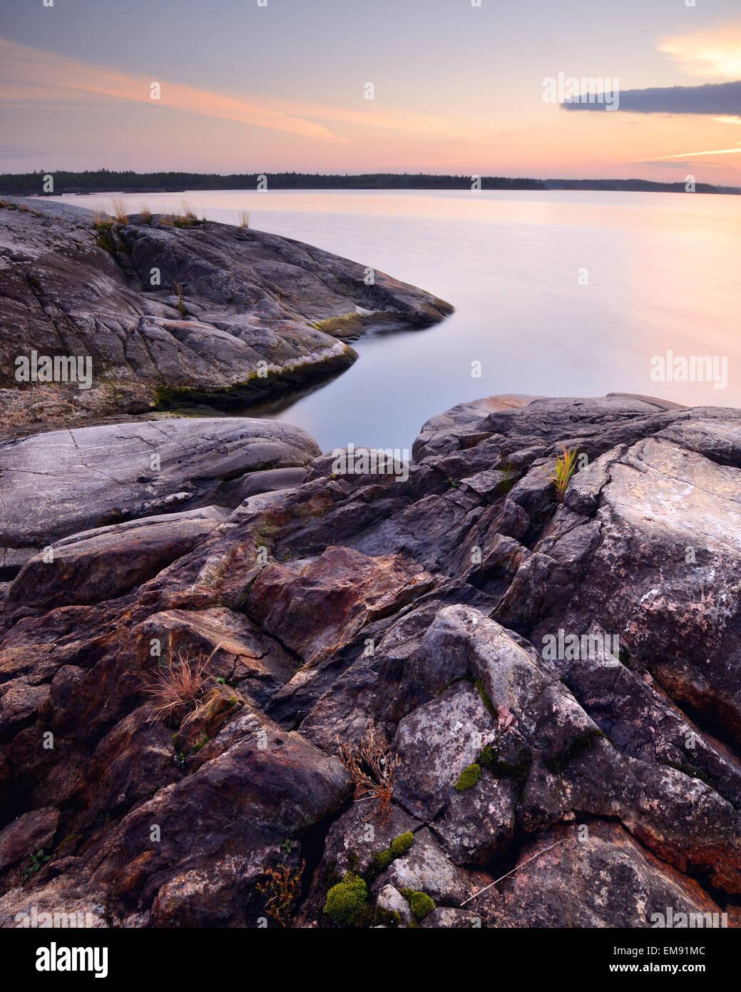 Rocks on Iso Koirasaari Island at sunset, Ladoga Lake, Republic of Karelia, Russia - Stock Image