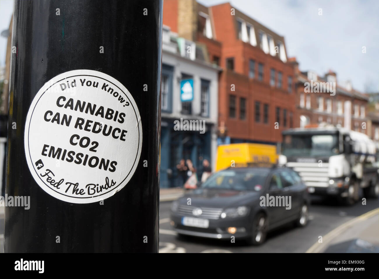 cannabis can reduce co2 emissions sticker, part of a legalise cannabis campaign, in twickenham, middlesex, england - Stock Image