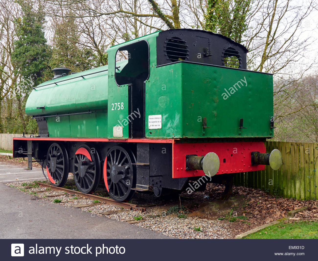 a green and red saddle tank steam locomotive 2758 in crynant colliery car  park near neath in south wales