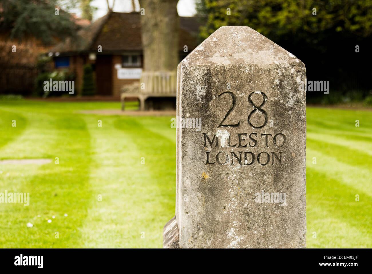 Mile Stone in Chobham UK reading 28 Miles to London - Stock Image