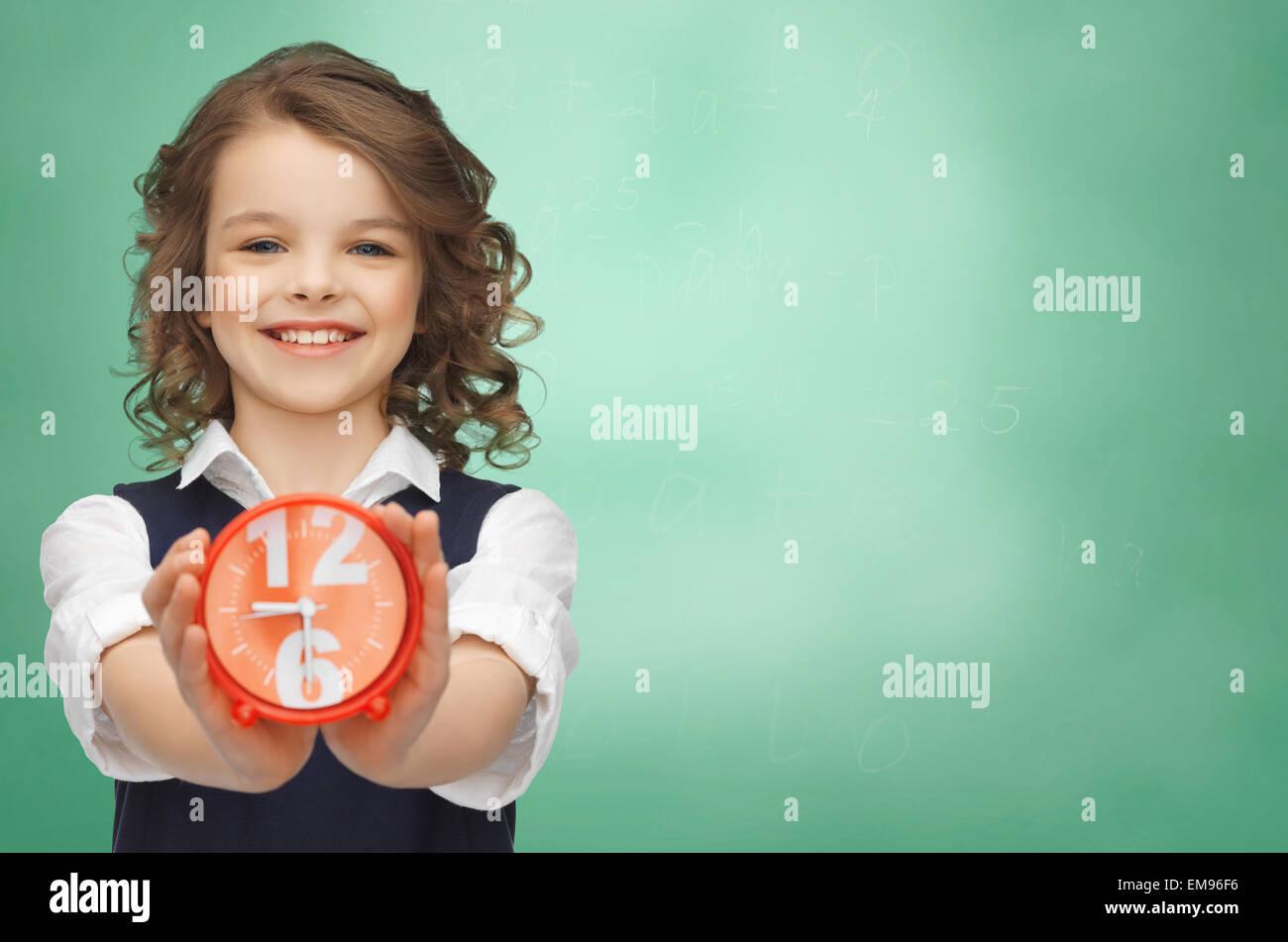 happy girl with alarm clock - Stock Image
