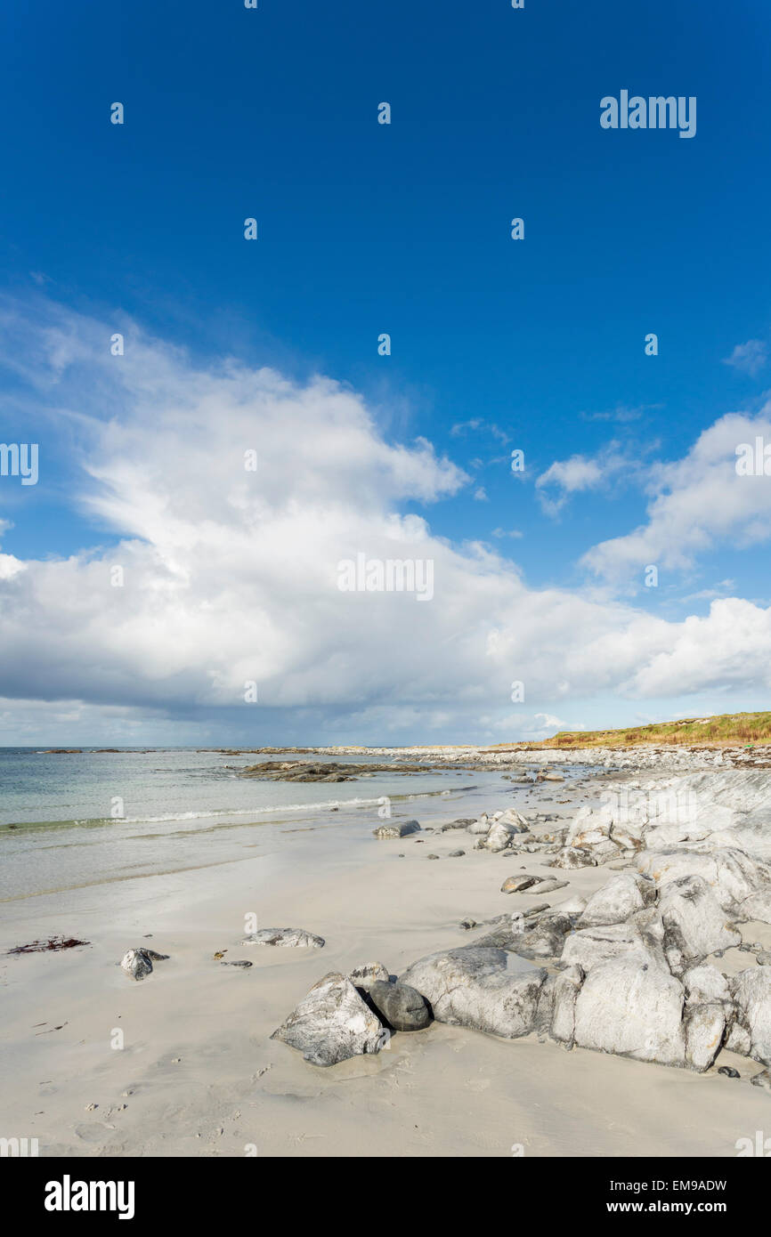 white sandy beach with blue sky and cloud of Ardivachar Point, South Uist, Outer Hebrides, Scotland - Stock Image