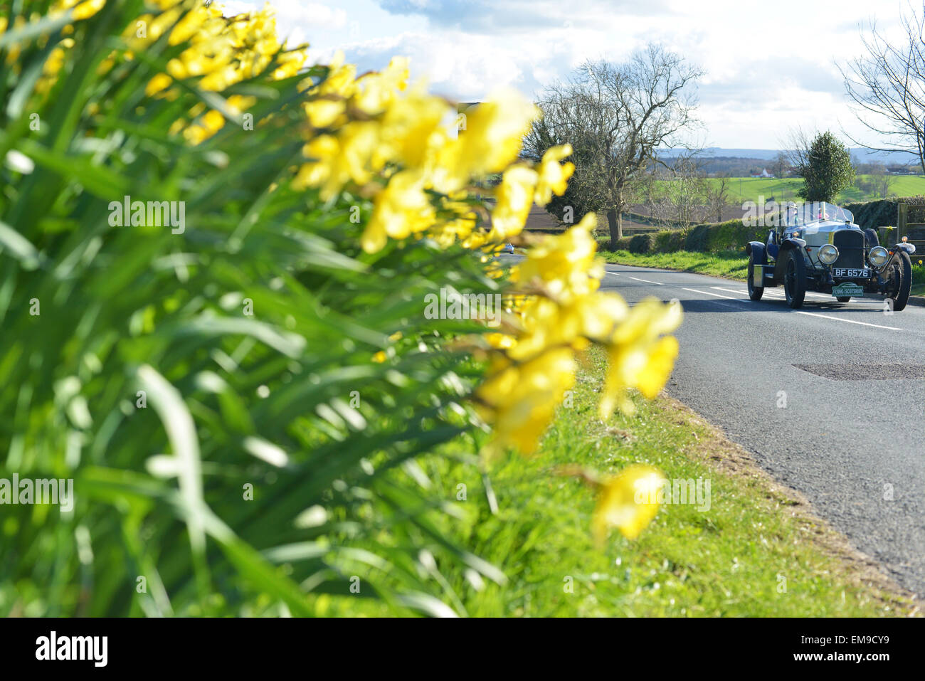A Vauxhall 23/60 Wensum vintage car drives through the village of Ingleton, Co. Durham during the Flying Scotsman - Stock Image