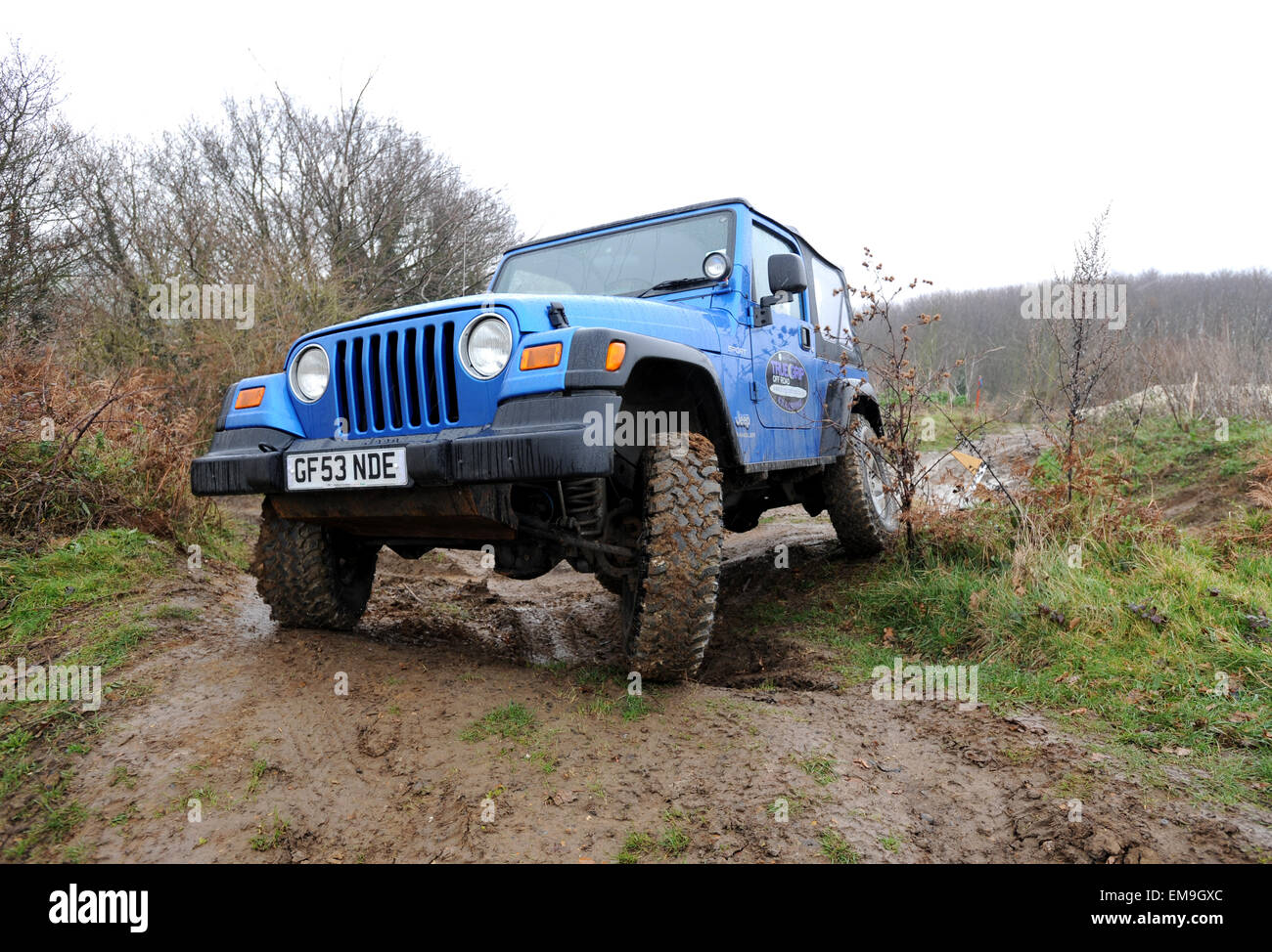 Modified Jeep Wrangler Driving Off Road In Deep Wet Mud And Water
