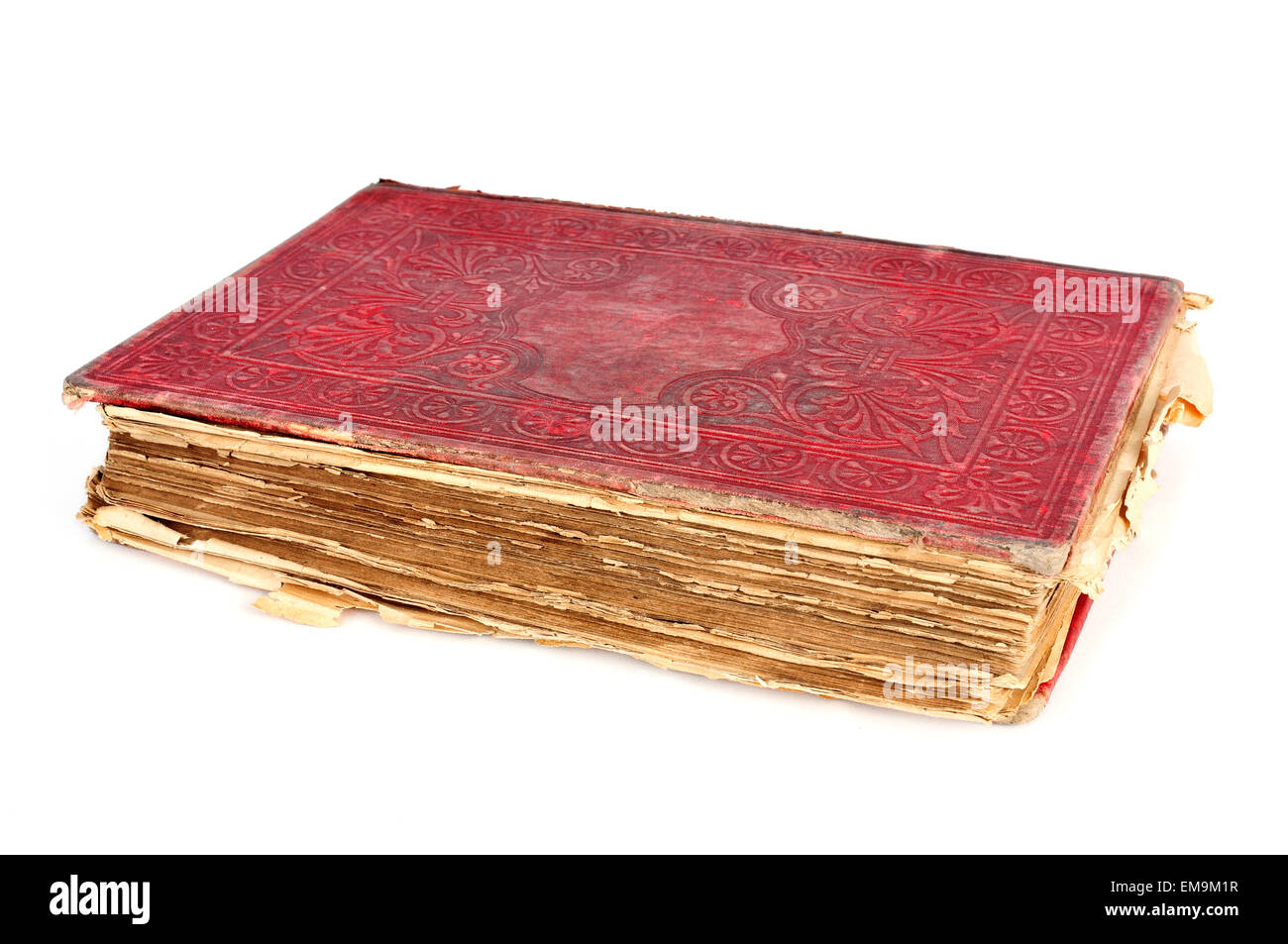a worn-out old book with a red cover on a white background - Stock Image