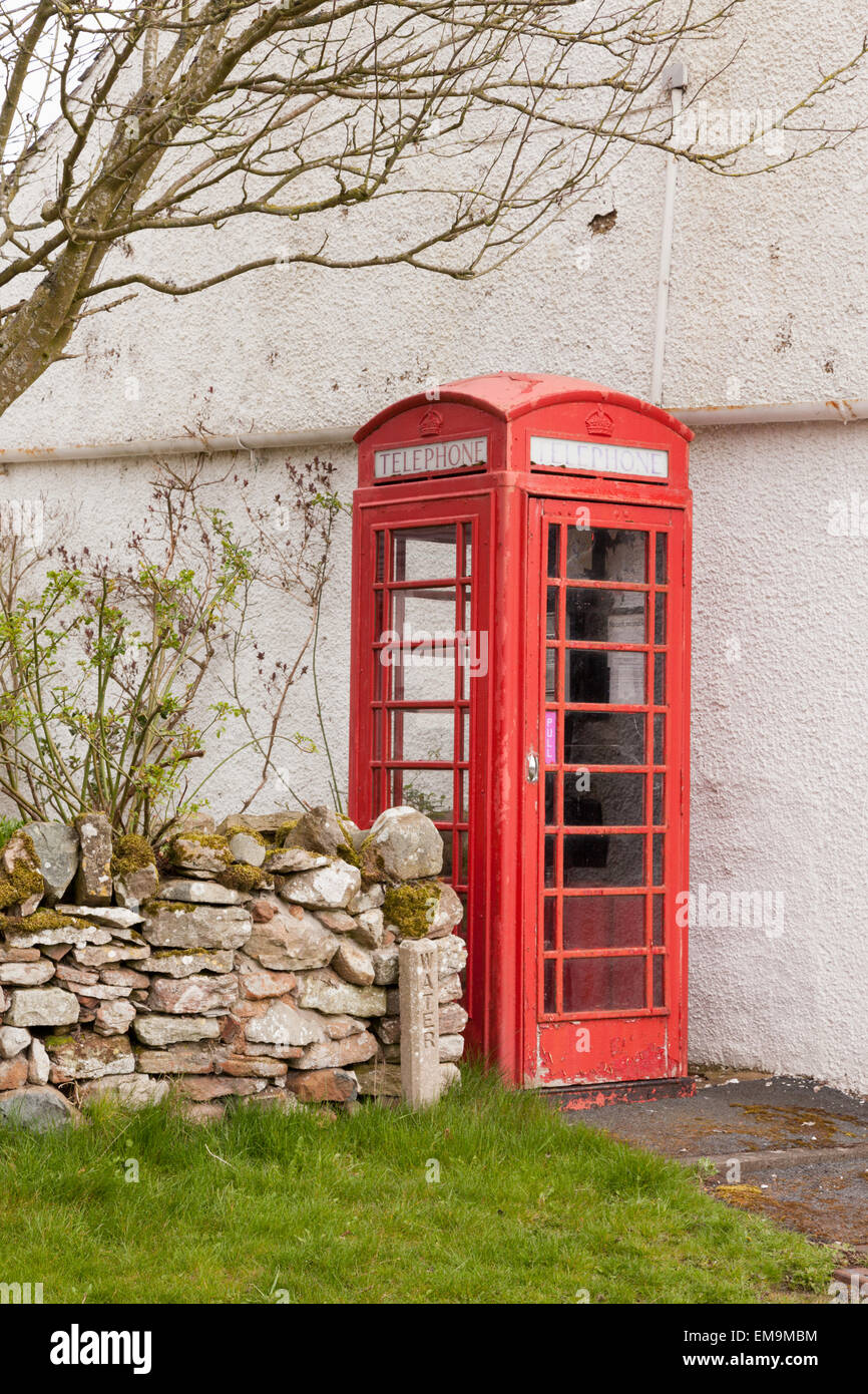Old fashioned public telephone box, rural Lake District, UK - Stock Image