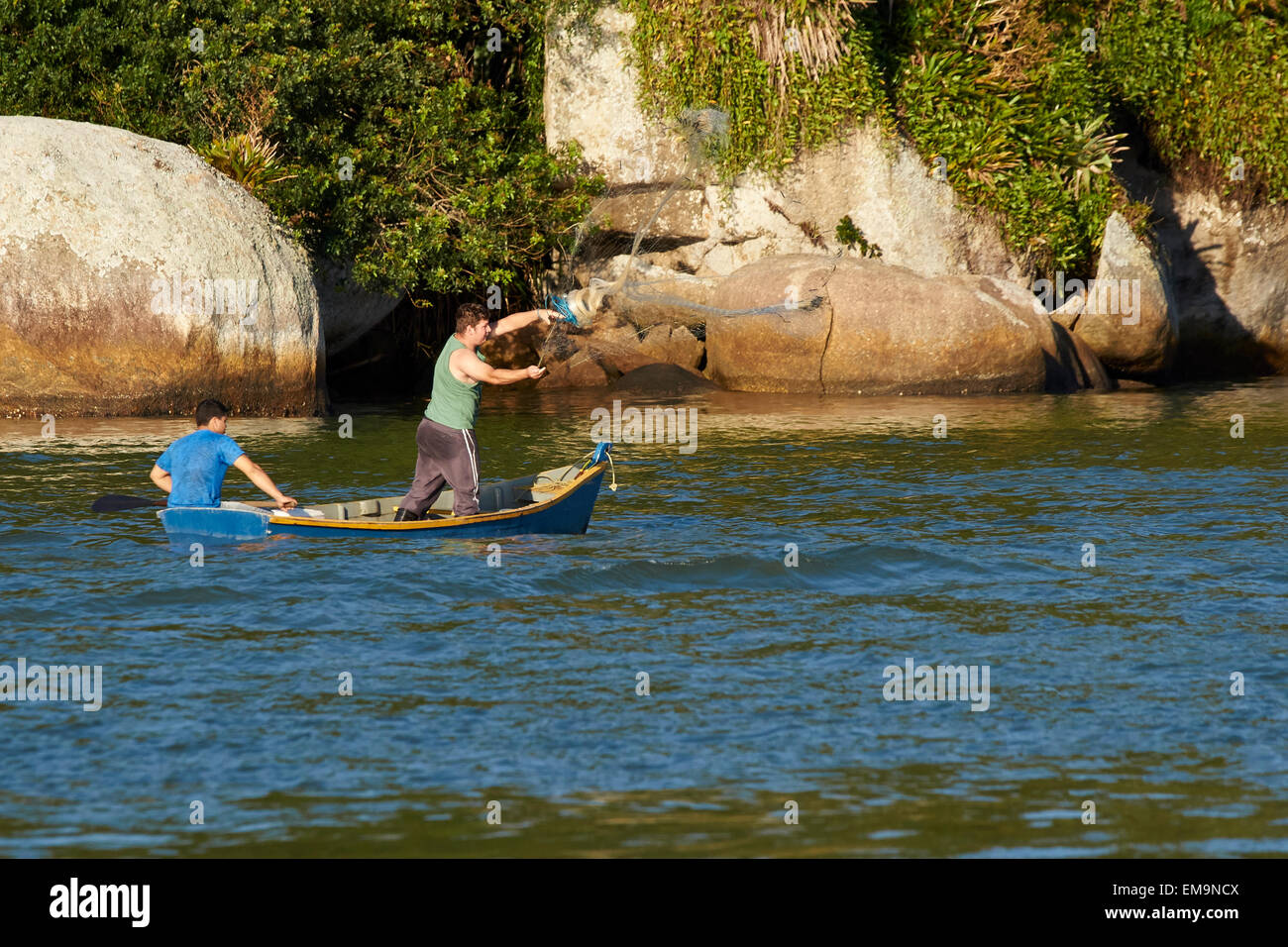 Fishing with a throw net - Stock Image
