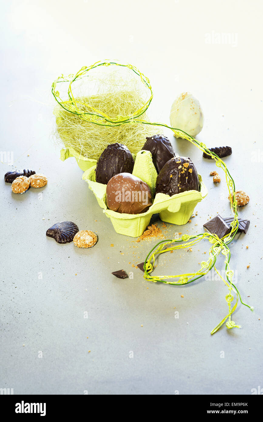 Easter eggs on wooden table. Holiday background - Stock Image