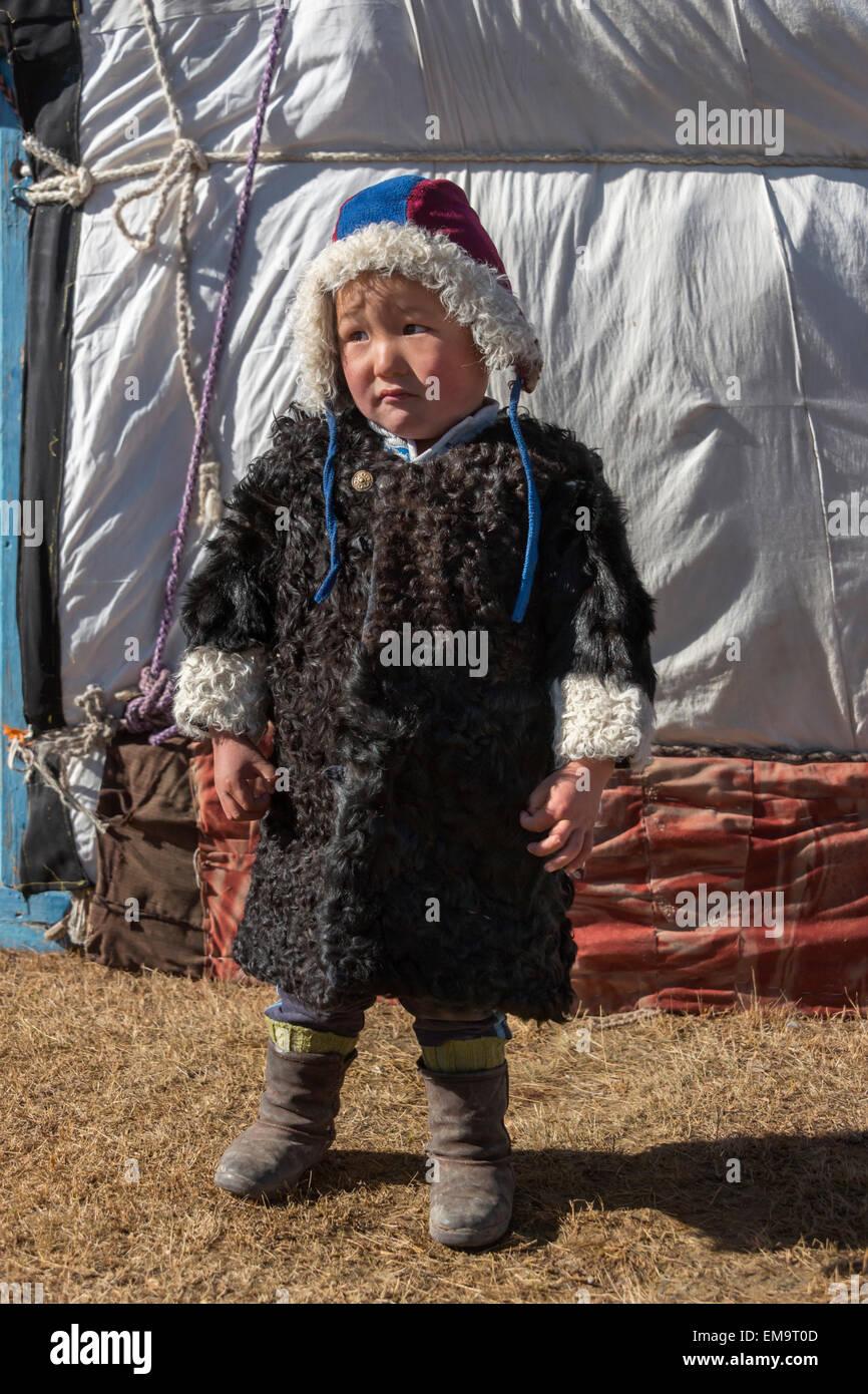 young-kazakh-boy-in-a-sheep-skin-coat-ou