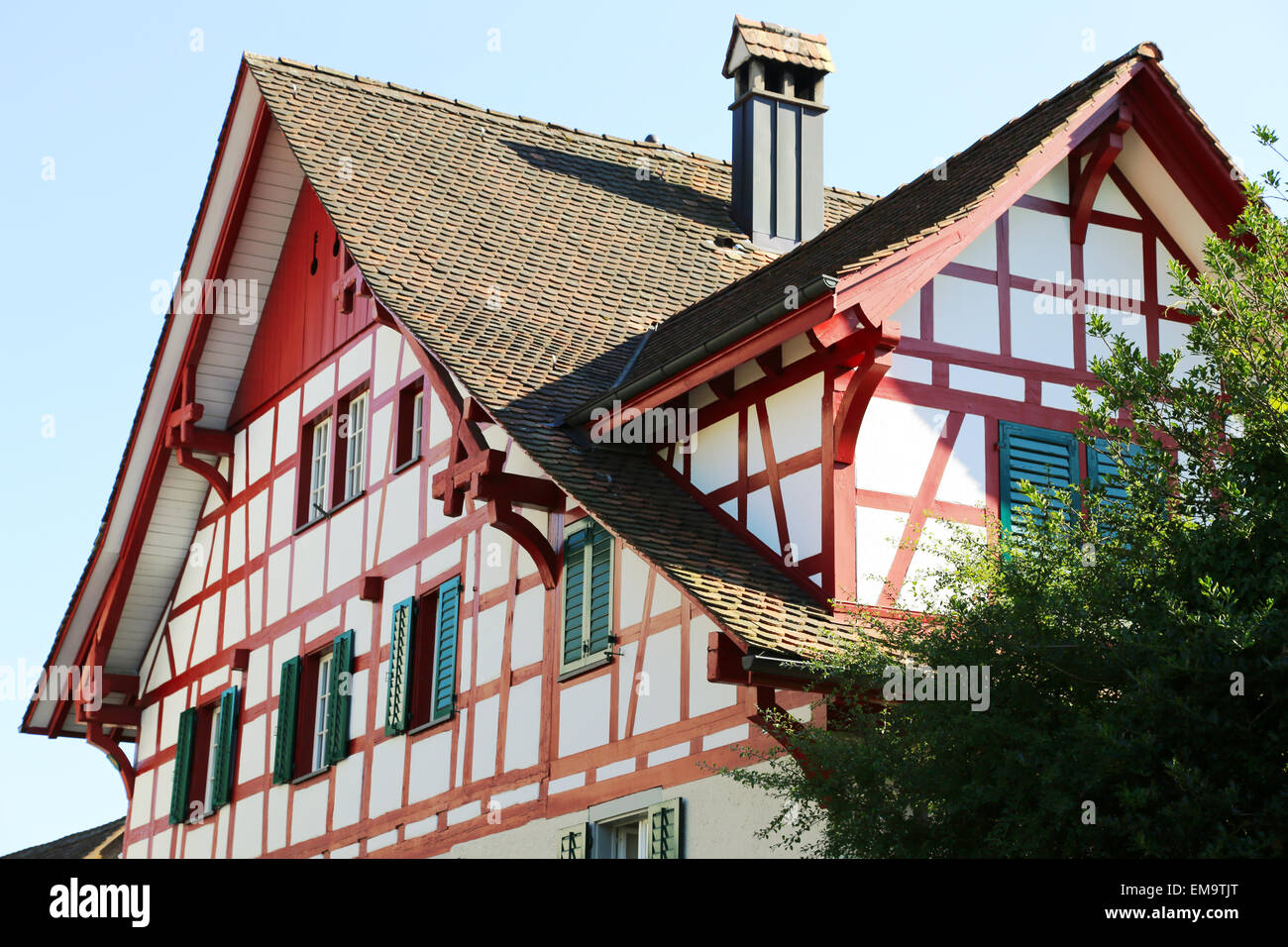 Swiss chalet with window shutters Stock Photo