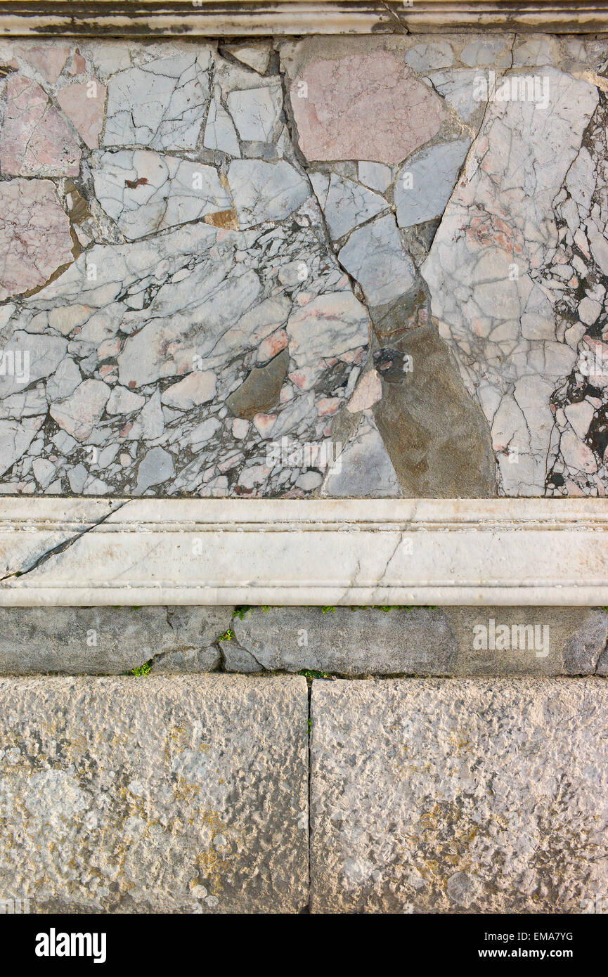 Pompeii, Italy. Detail of marble stonework on a plinth in the ruined roman city - Stock Image