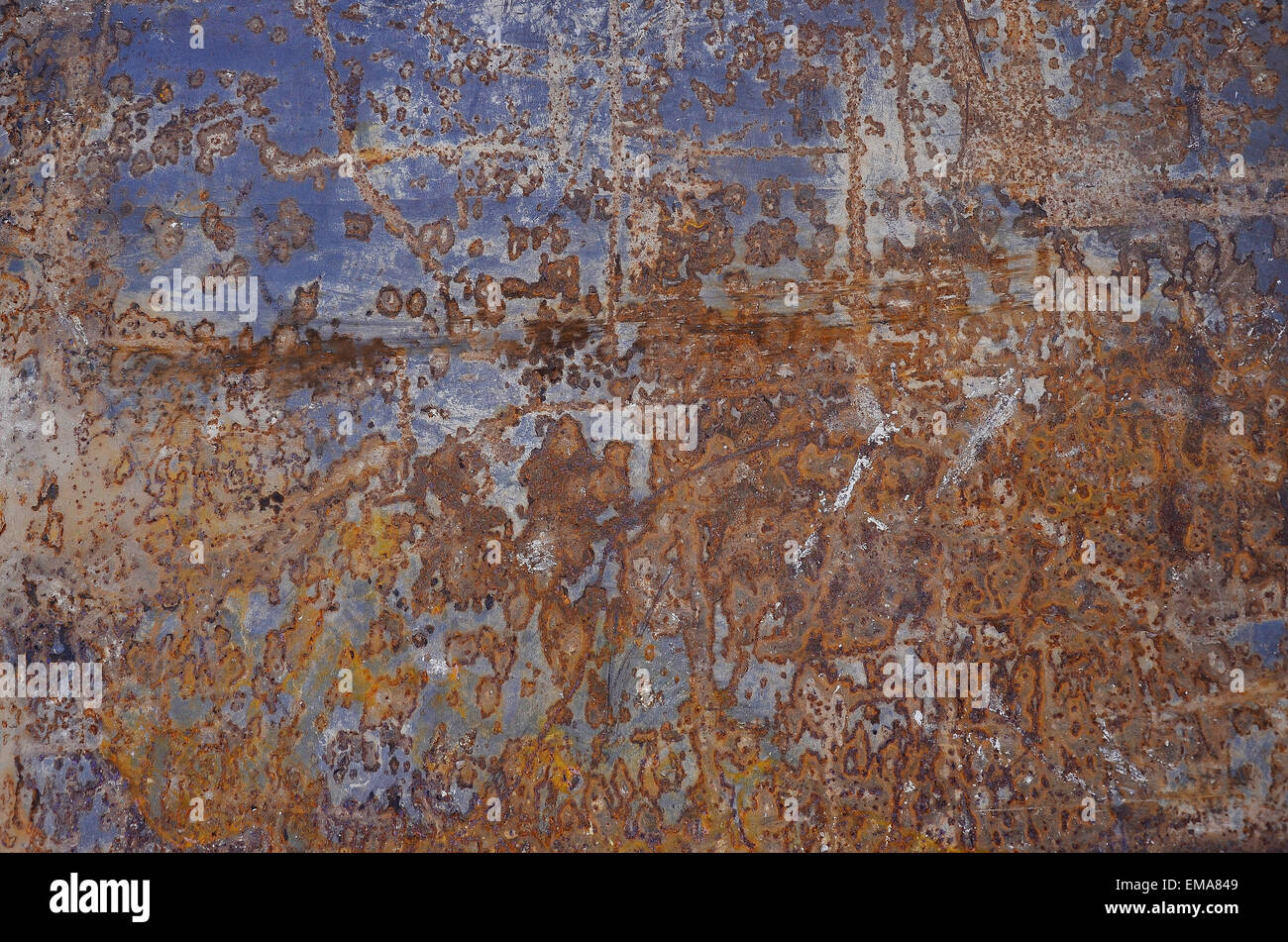 A blue reflection of the sky on a rusty steel plate at road works in France - Stock Image
