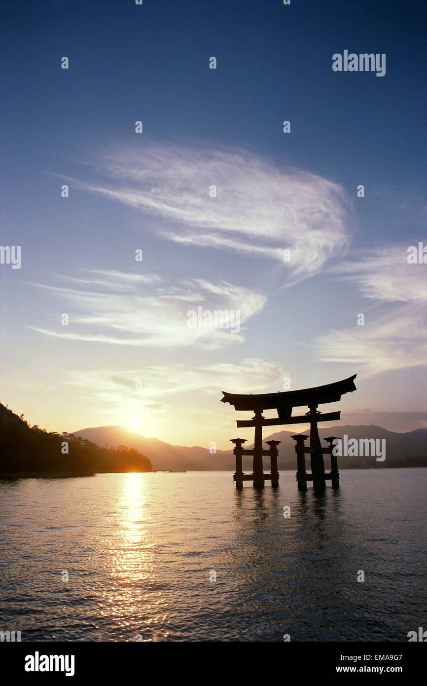 Japan, Miyajima Inland Sea, Itsuku Shima Shrine At Sunset, Wispy Clouds - Stock Image