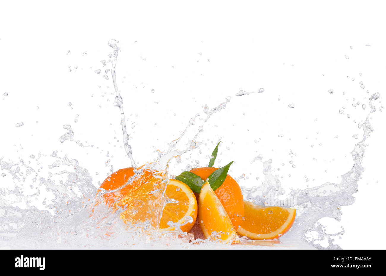 Fresh oranges with water splashes isolated on white background - Stock Image
