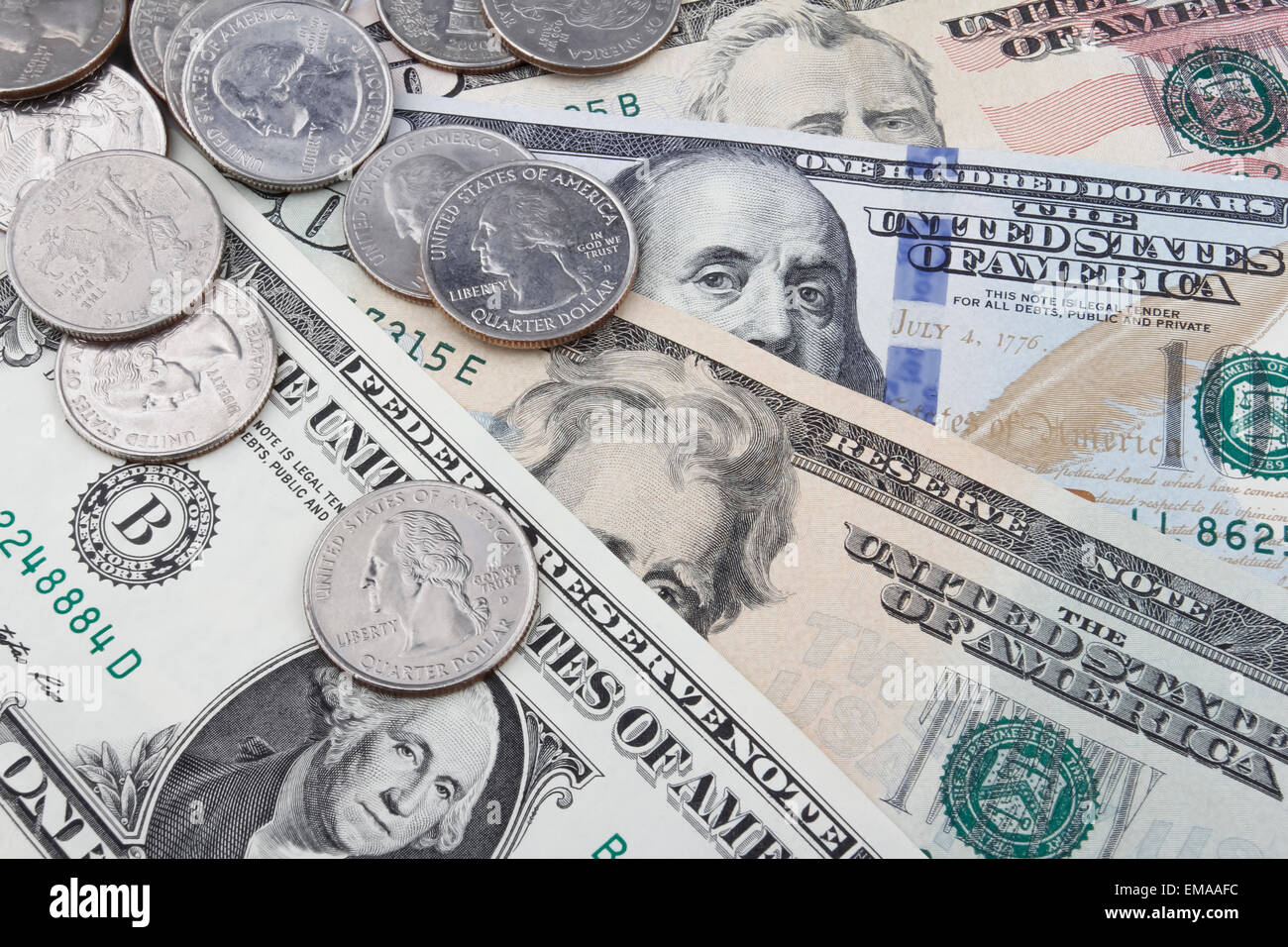 US Dollar (USD) banknotes and coins, coins in upper left corner. - Stock Image