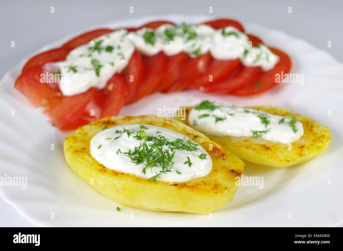 Outstanding Baked Potato With Cottage Cheese Chives And Tomatoes On A Interior Design Ideas Gentotryabchikinfo