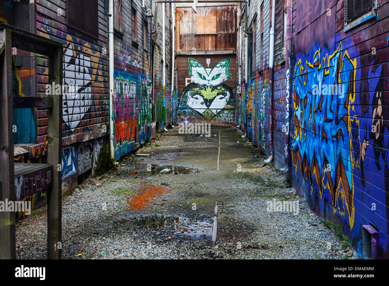 Back alley between older industrial warehouses on the east side of Vancouver - Stock Image