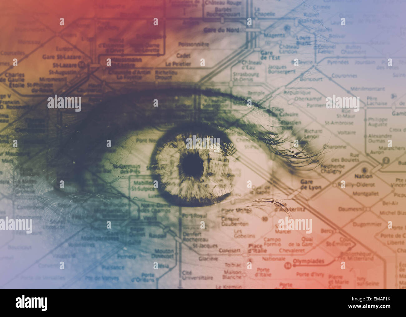 Travel can be confusing and scary. A map of the Paris underground over a fearful eye with stressful colors. - Stock Image