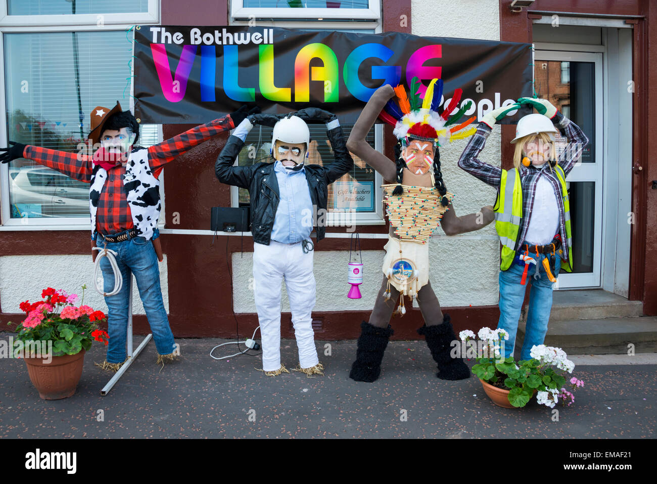 Scarecrows at scarecrow festival. - Stock Image