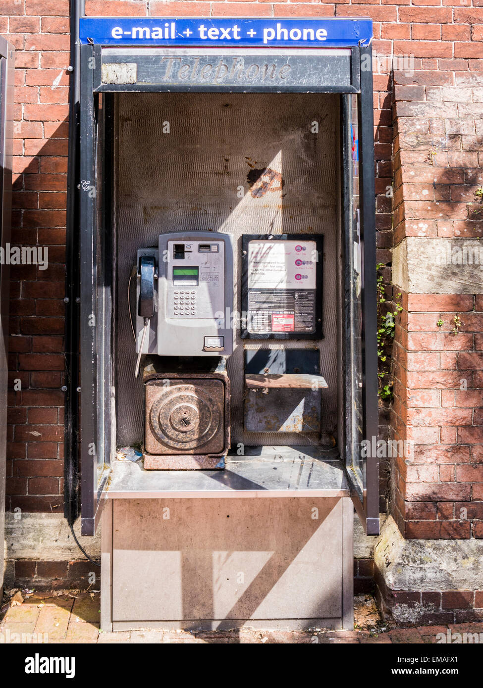 A public communication centre (telephone box). - Stock Image
