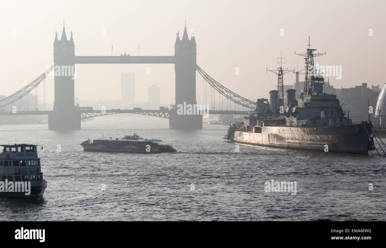 Heavy smog lies in the morning air with an easterly view of Tower Bridge in London showing pollution from carbon - Stock Image