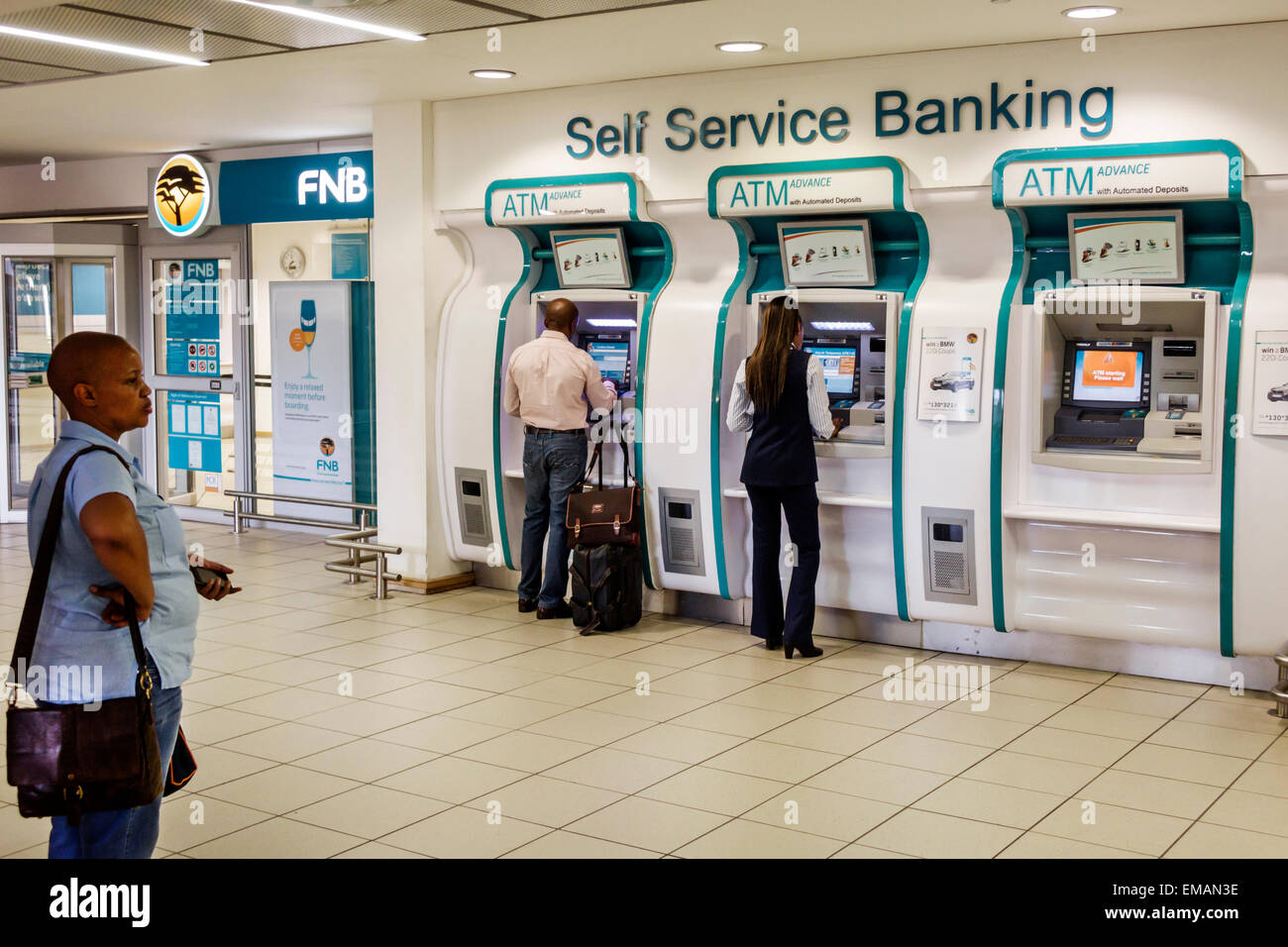 Johannesburg South Africa African O. R. Tambo International Airport terminal concourse gate area FNB self service - Stock Image