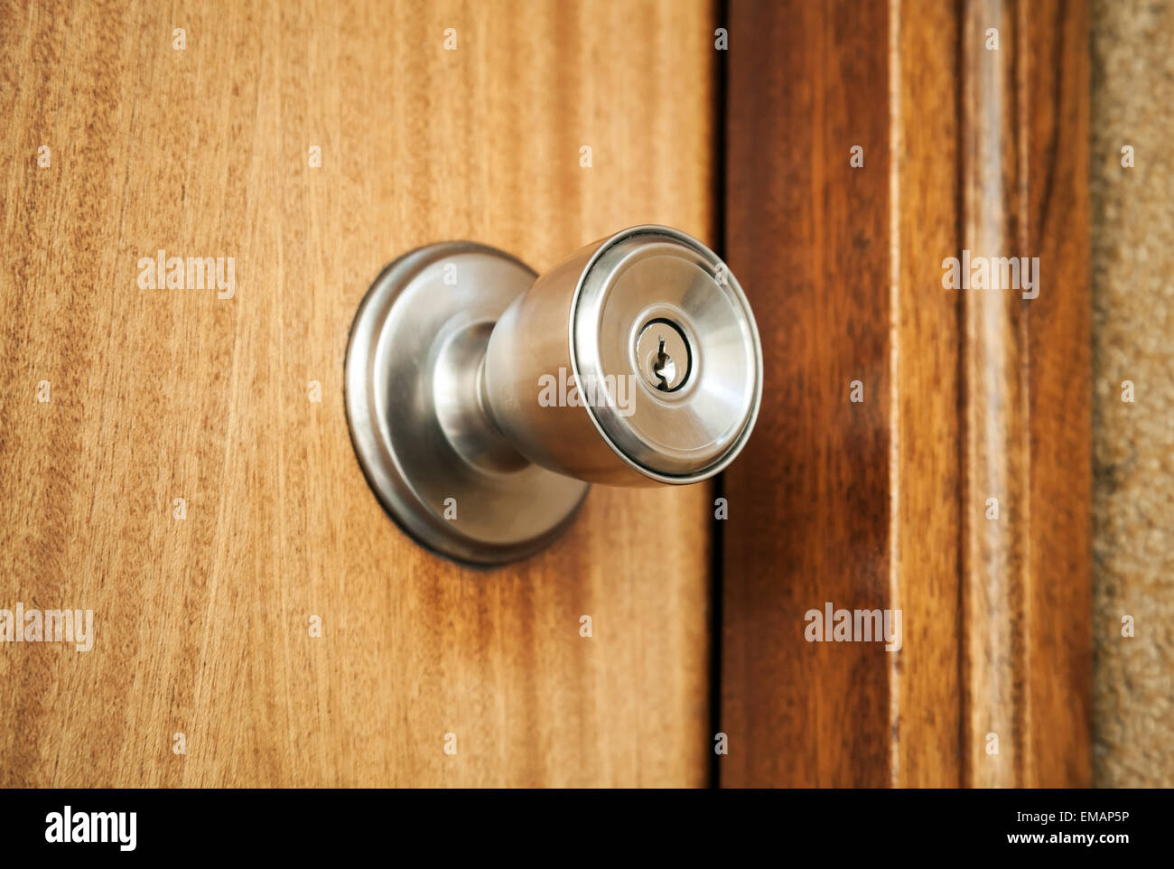 Shining metal door handle with keyhole in closed wooden door photo with selective focus and shallow DOF & Shining metal door handle with keyhole in closed wooden door photo ...