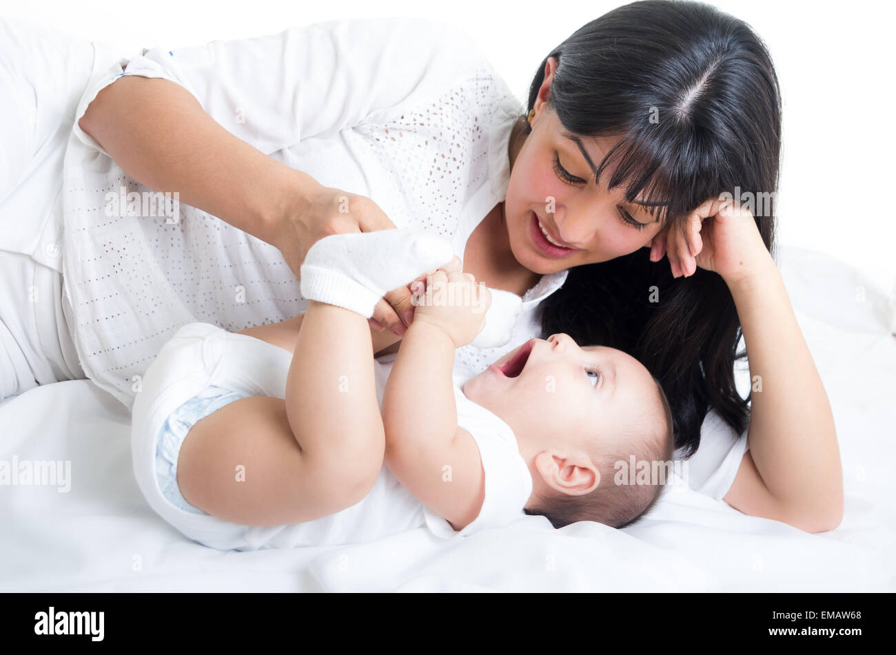 Beautiful Young Mom Staring At Her Small Cute Baby Stock Photo