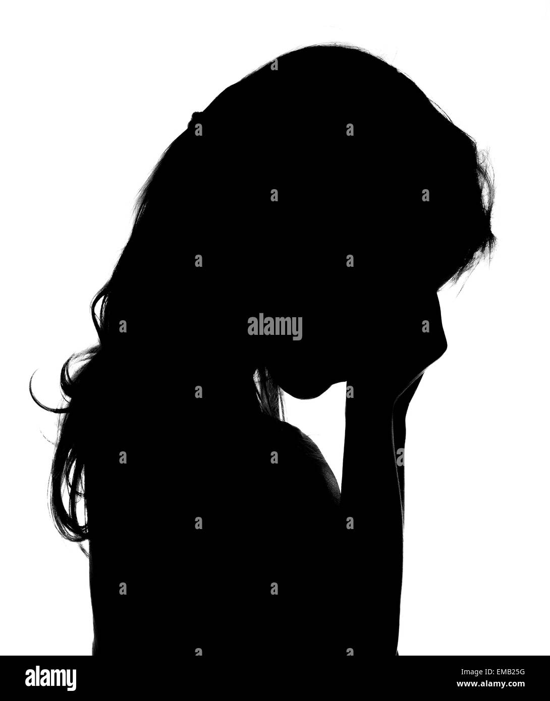 Silhouette of crying little girl. - Stock Image
