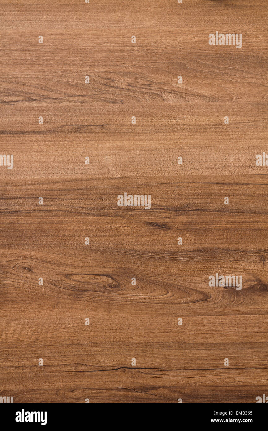 Texture of veneer in pale brown tones with a darker shade imitating walnut - Stock Image