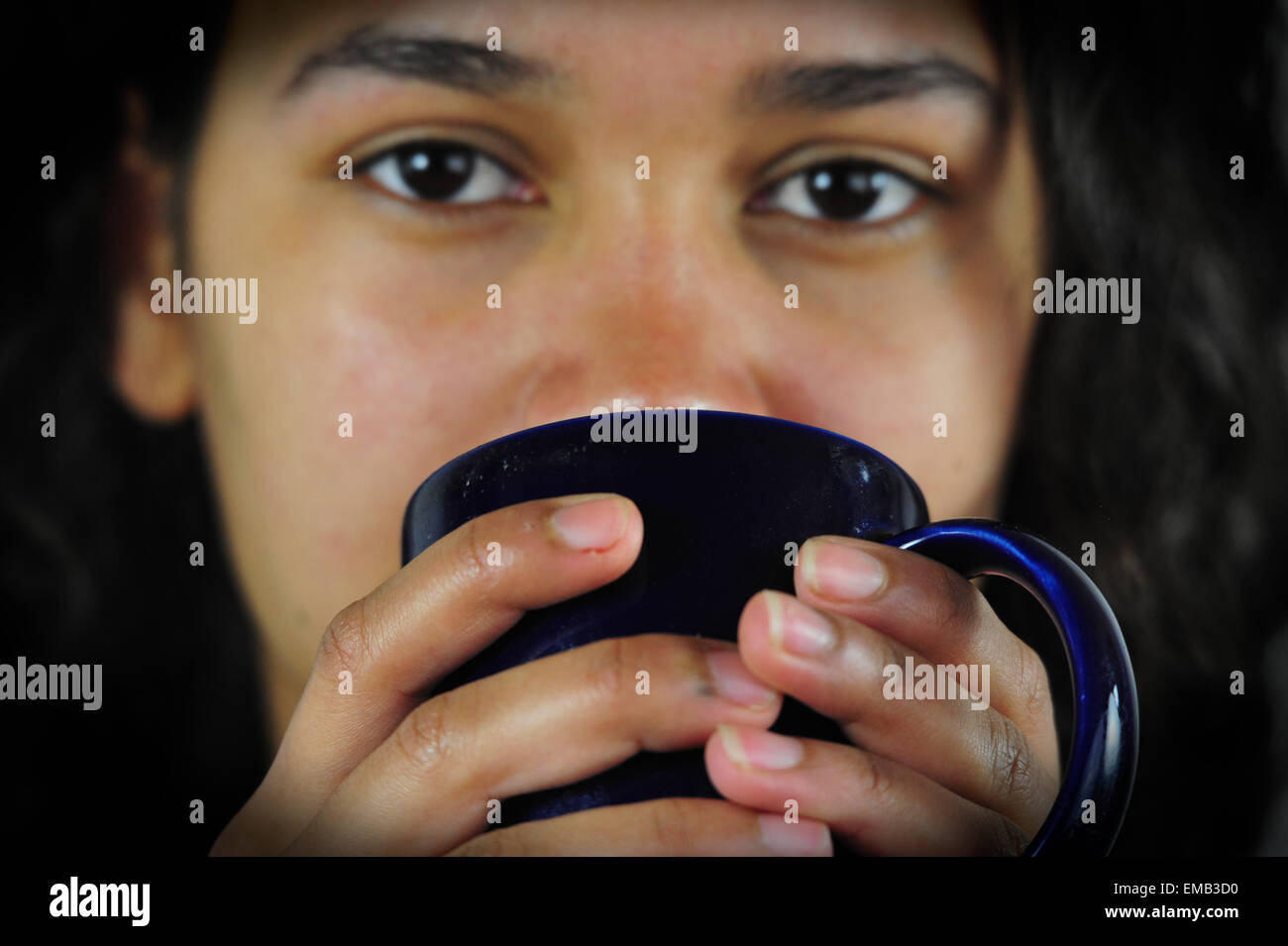 Girl with Coffee Cup, Studio, Hamburg, Germany. Incl. Model Release. - Stock Image