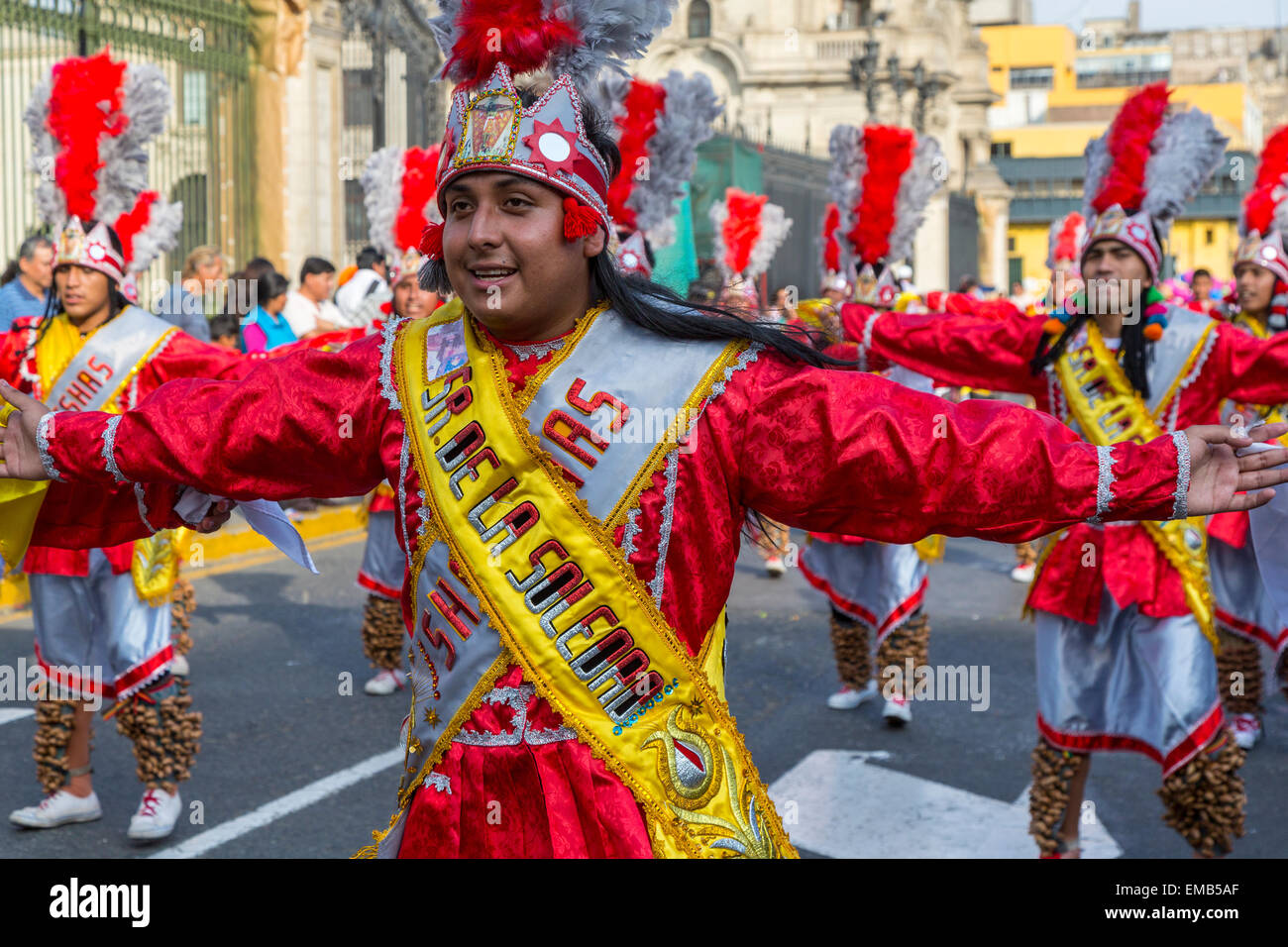 Lima, Peru.  Young Peruvian Men Marching in an Andean Cultural Parade, Plaza de Armas. - Stock Image