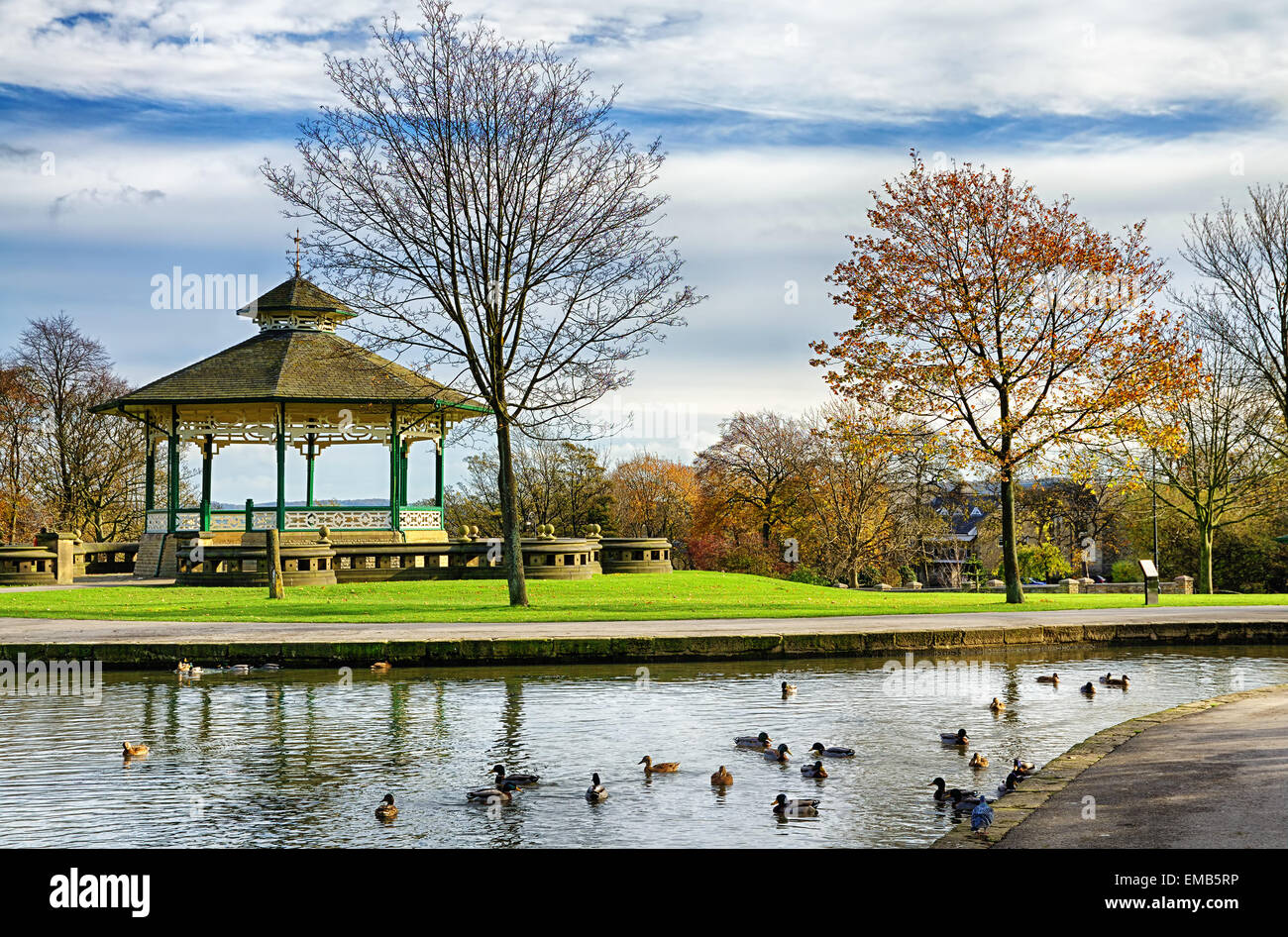 Bandstand and duck pond in Greenhead park, Huddersfield, Yorkshire, England - Stock Image