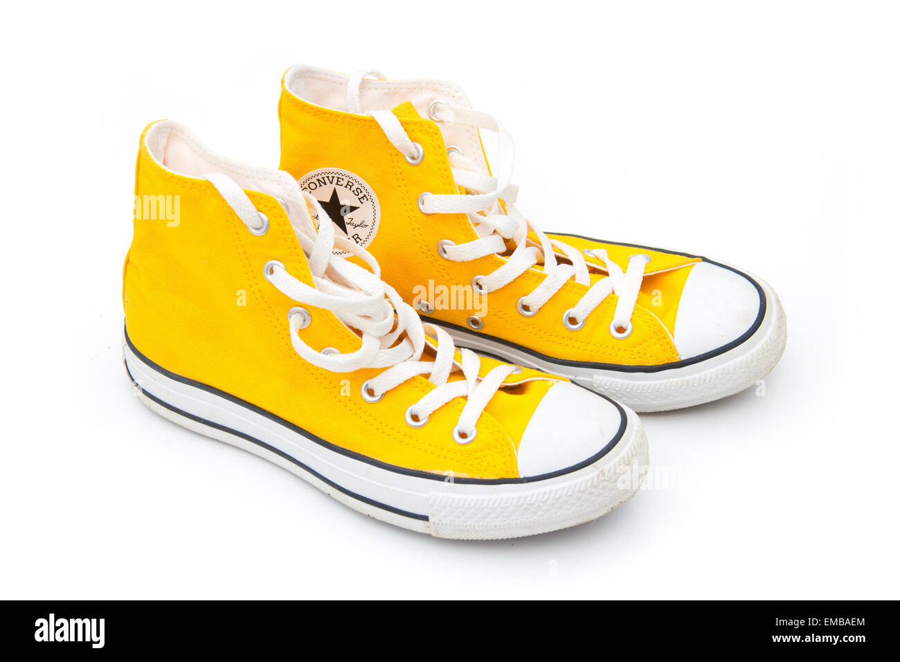 Yellow Converse boots isolated on a white studio background. - Stock Image