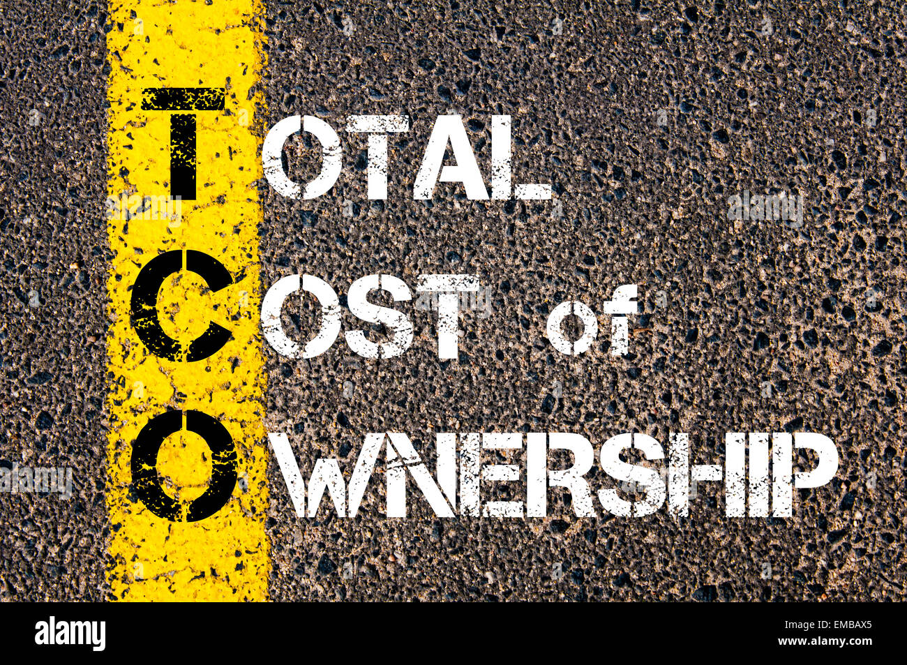 Business Acronym TCO as Total Cost of Ownership. Yellow paint line on the road against asphalt background. Conceptual - Stock Image