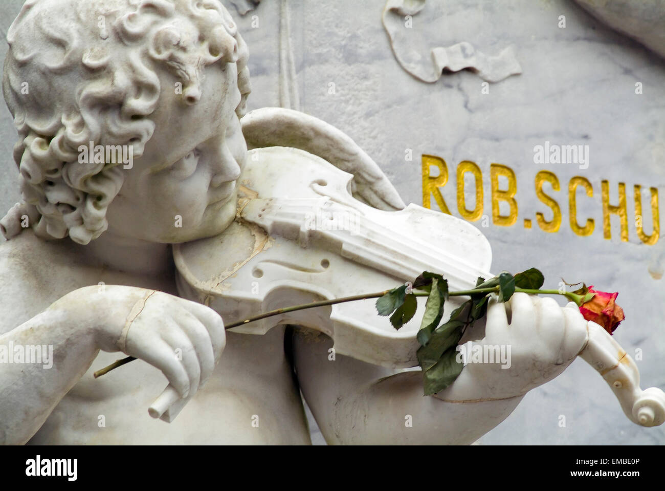 Angle with rose on the graveyard of the famous musicians Robert and Clara Schumann in Bonn Germany Europe Stock Photo
