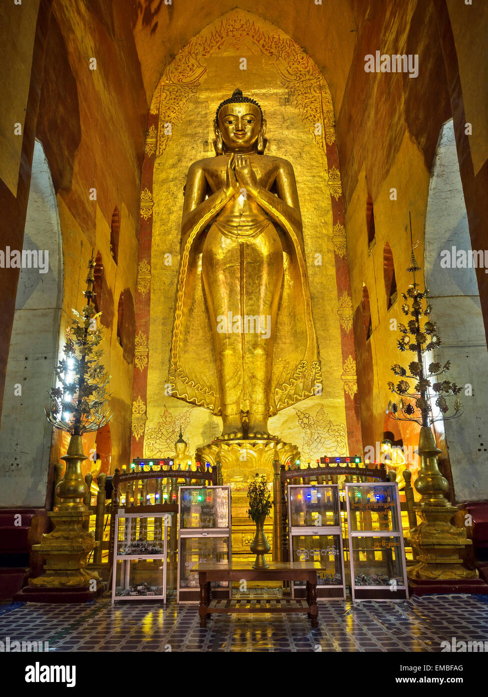Revered standing Buddha statue in the ancient Ananda temple in Bagan, Myanmar (Burma). - Stock Image