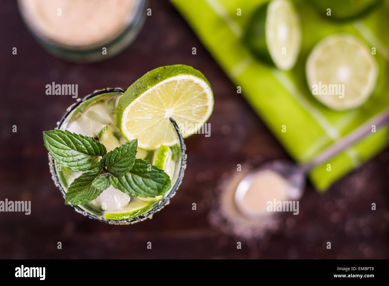 Mojito Lime Alcoholic Drink Cocktail on Wooden Table Overhead - Stock Image