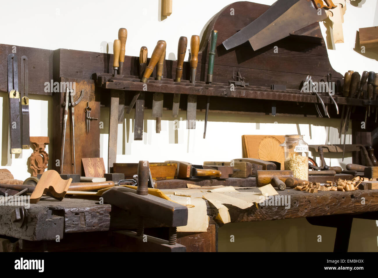 Woodworking tools and components on workbench - Stock Image