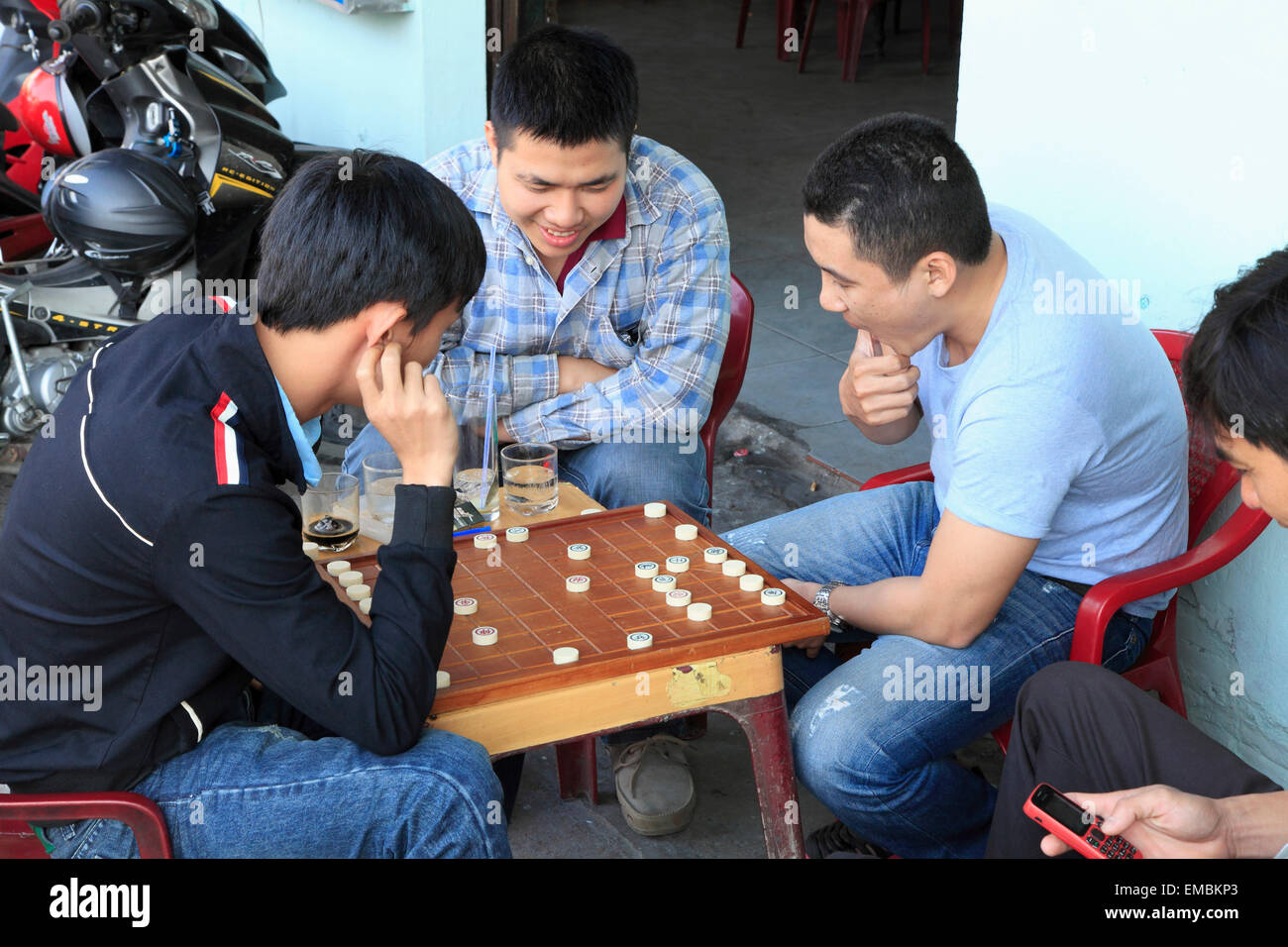 Vietnam, Hoi An, men playing chinese chess, - Stock Image