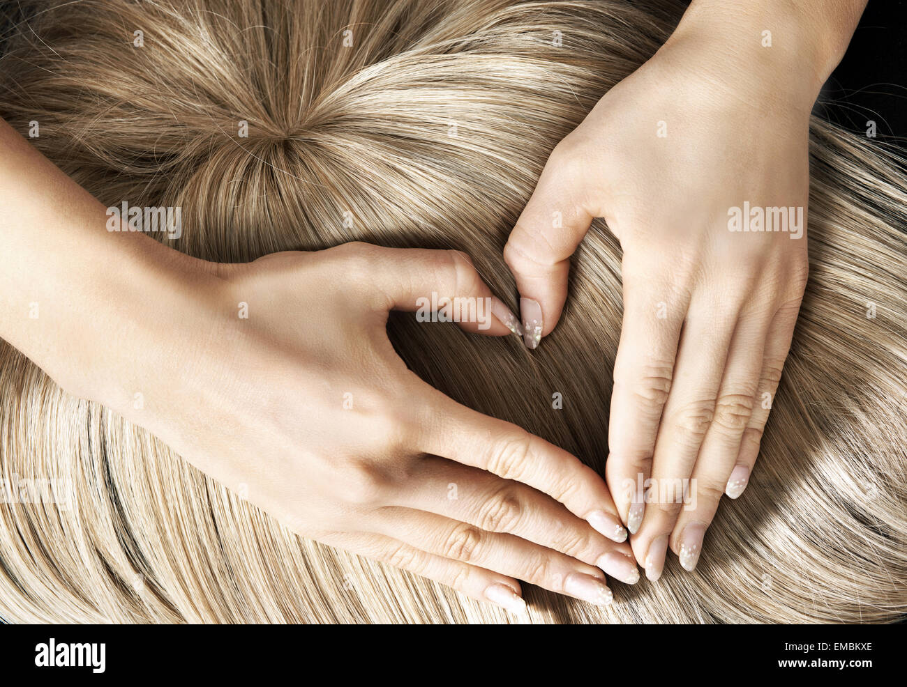 Heart sign on the blond hairpiece - Stock Image