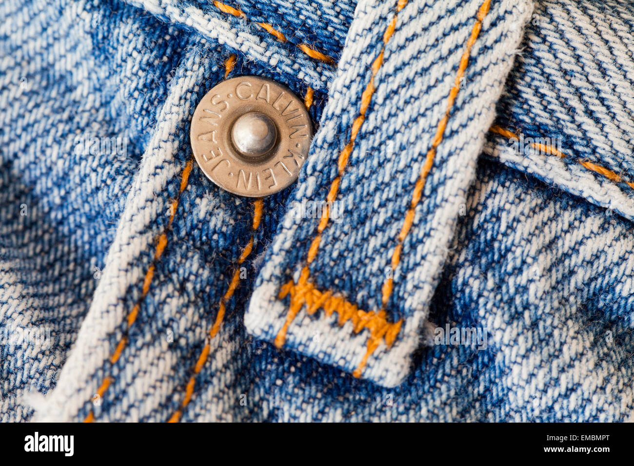 Belt loop and rivet on pair of Calvin Klein blue jeans - Stock Image